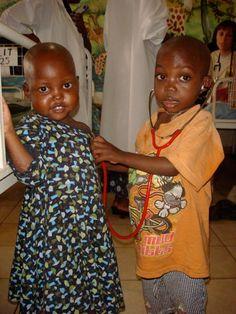 Children playing doctor in the pediatric ward at Rwinkwavu Hospital in Rwanda. (Alishya Mayfield, 2007)