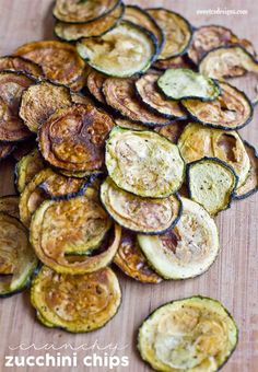 These easy baked zucchini chips are a crunchy, delicious and salty snack that works with a paleo, vegan, or whole 30 diet. Great for parties!