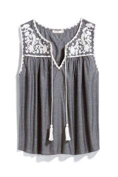I like this, the folky embroidery is a nice pop but I like that's it's monochromatic. I don't love the the tassel strings. I'm not going to tie them and then they just hang there getting caught in things.