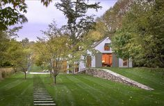 Modern farmhouse with field stone wall and pavers - click for more pics