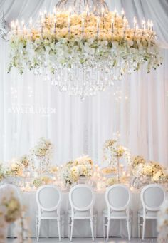 Featured in @WedLuxe. Love the chandelier with flowers nested in it #mystyle