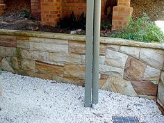 Stonehenge Stone Masons Sydney offers construction of sandstone home, retaining wall, stone fireplaces and other stone masonry works. Stone Retaining Wall, Retaining Walls, Stone Masonry, Stonehenge, Garden Ornaments, Cladding, Outdoor Decor, Sydney, Lawn Ornaments