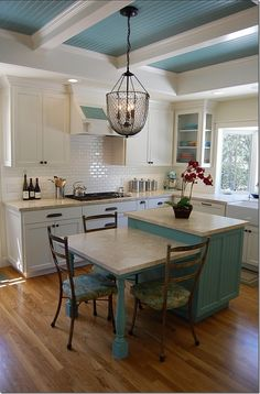 Countertops and corner glass-front cabinets