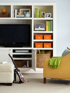 Media Storage Sense: Frame the television with a bounty of storage and it's easy to find the necessary gear for a fun-filled night at home. The trick is to realize the space around the TV is finite; save it for your commonly used media. Put the overflow in out-the-way storage.