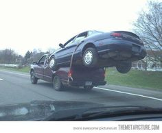 Truck carrying a car! - Overloaded