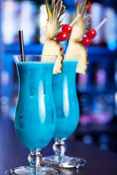 Blue Hawaii Cocktail.  cheers www.voltvacations.com  0.75 oz Rum  0.75 oz Blue Curaçao  2 oz Pineapple Juice  0.75 oz Coconut Cream  Recipe:   1.Pour the ingredients into a hurricane glass with ice cubes.   2.Stir well.   3.Garnish with the cherry and pineapple