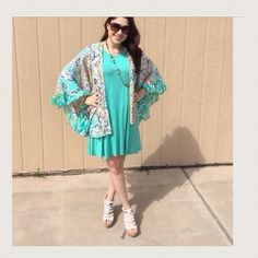 "Listing Flowy Teal Dress Gorgeous and comfortable. Pair with the colorful kimono. I have  several colors of this dress. 35"" hi and 39"" Lo. Small PTP is 23"", Medium PTP is 26"", Large PTP is 27"", XL PTP is 28"" . 95% rayon and 5% spandex. BUNDLE and save. Kimono is 34"" long. And is 100% poly. Model is wearing a size Small. Comes in S-M-L-XL Boutique Dresses Midi"