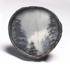 Brooks Shane Salzwedel is a California-based artist whose mixed-media art juxtaposes man-made constructs and nature.
