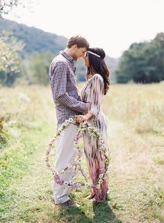 engagement photos with a bohemian twist and a floral peace wreath