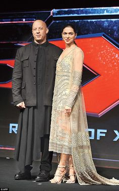 Vin Diesel (Left) and Deepika Padukone pose during a press conference for the promotion of xXx: Return of Xander Cage