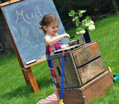 Outdoor mud kitchen for pretend play in summer