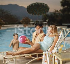 Father and son playing with beach ball while mother royalty-free stock photo