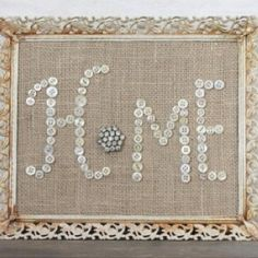 HOME - I like the idea of using an old brooch or arrangement of buttons for the O, but a wooden frame would better suit the burlap picture in my house. (via just ...