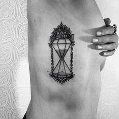 Hourglass by Anka Lavriv (@ anka.tattoo)