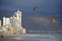 Windsurfing during winter on Strand's Golden Mile - Hibernian Towers as well as Gordons Bay and the Hottentots-Holland mountain range as backdrop. Sa Tourism, Best Family Beaches, Sup Surf, Beach Road, Water Photography, Windsurfing, Big Challenge, Big Waves, Mountain Range