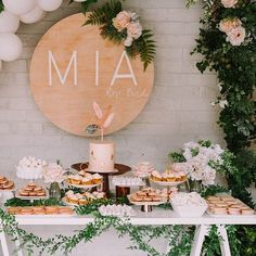 Using a colour palette of white, blush pink  and rose gold, an abundance of blooms, cocktails, and handmade signage,  this backyard party is everything our first birthday dreams are made of!