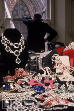 """""""People will stare. Make it worth their while."""" - Harry Winston ~1960 photo of Harry Winston and an array of jewels~"""