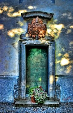 sun dappled door, a mausoleum door?
