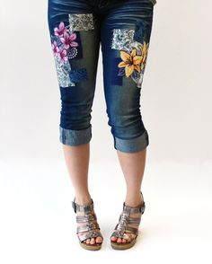 Urban Threads: Petals & Lace embroidery collection. They make pretty awesome capris!
