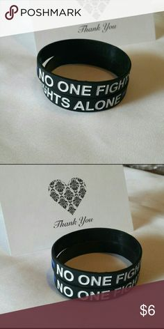 No one Fights Alone Silicone Bracelet No one Fights Alone Silicone Bracelet 1@6 2@10 3@15  one size fits most blue and black no rude or unnecessary comments Jewelry Bracelets