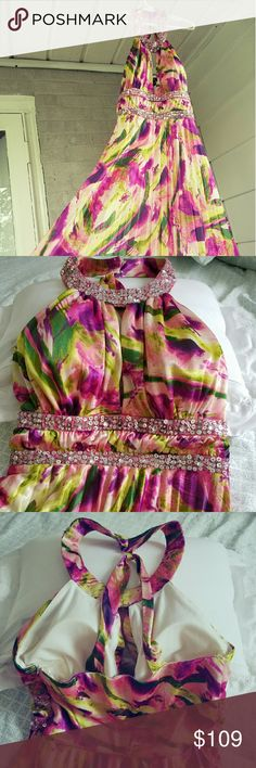 Prom dress Hawaiian-style long silky prom dress with sequin detailing around neckline & beneath bust.  Backstraps for extra support.  Lining underneath.  Size 3/4.  200% polyester.  Worn twice -- great condition!   Very unique & fun!  Price negotiable. XOXO Dresses Prom