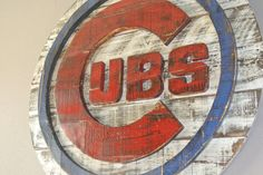 This 3D Chicago Cubs baseball wall art was originally a custom Christmas present from a Dad to you his young Cubs fan. Both were thrilled with it and Its now one of my most popular pieces. I even had a friend who is a fan of a rival team say he would buy it because its so cool. So here it is.  This piece has a Diameter of 31 inches and comes equipped with a hanger on the back ready to be easily hung. Its two layers, as the 3D look is my specialty. Its hand cut, hand painted, and distressed…
