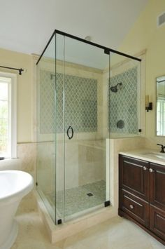 LOVE this arabesque tile as an accent in the shower.