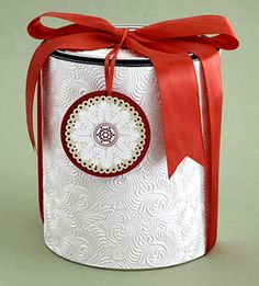 paint can packaging using embossed paper - makes it look more gift-y and less paint can-y.