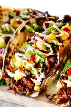 Up Close of Pulled Pork Taco with Pineapple Slaw on a cutting board