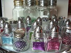 Michaels has these small salt and pepper shakers on sale now for $1.00. What a great way to organize glitter.
