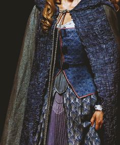 blue cloak and blue/purple dress