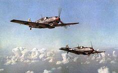 Two Messerschmitt Bf 109 E's in flight.