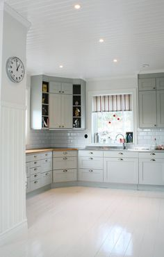 Love the corner cabinet, but it would be hard to open other cupboards/drawers at the same time