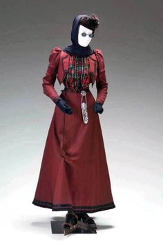 Walking suit, American, circa 1890-95. Wool, silk taffeta. Why they put the mannequin on skates, I don't know. Mint Museum