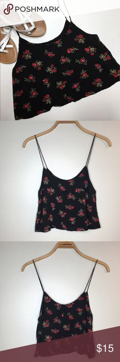 Brandy Melville Floral Crop Top Like new Brandt Melville black floral crop top. Tag is sized one size. This is best fit for XS-S though. Brandy Melville Tops Crop Tops