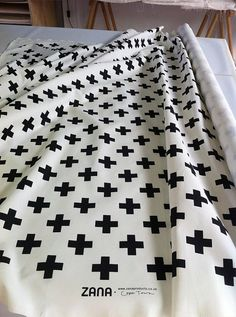 Swiss Cross in black  Fabric by the yard by ZanaProducts on Etsy, $45.00