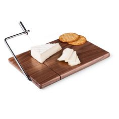 The Black Walnut Cheese Slicer & Cutting Board is a rectangular-shaped American black walnut cheese board with a built-in stainless steel cheese wire.