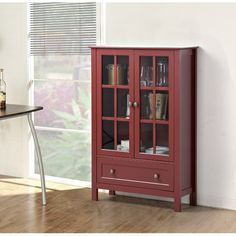 Set this stylish cabinet in the den to stow board games or vintage records, then adorn it with framed photos or a classic hydrangea bouquet for a lovely finishing touch.
