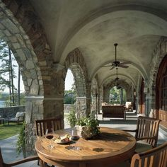 stone arches for covered porch entry way - yes please!