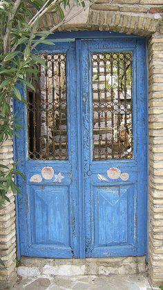 Blue door in Hydra, Greece by Thøger, via Flickr