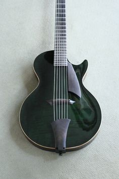 a viola dressed up as a electric guitar............ TOTALLY WANT IT!!!!
