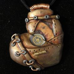 Steam punk heart necklace. Intricately hand worked polymer clay one of a kind creation by gloryhounddesigns on etsy