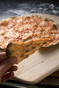 This pizza is so thin and crackly that light shines through it!  It's much easier to achieve perfection with this Tuscan specialty than you might think. You will need a good rolling pin, and the go...