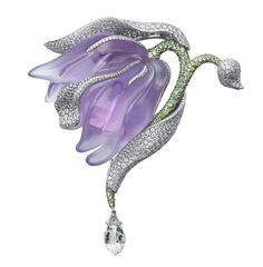 Cartier Caresse d'Orchidées brooch in platinum, featuring amethysts, garnets, briolette-cut diamonds and diamonds. PHOTO: Vincent Wulveryck © Cartier 2011.
