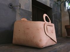 leather bins by Gildem.