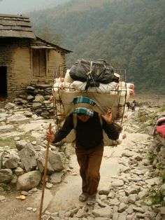 @ Nepal - Strong lady! transporting chickens up on trek!