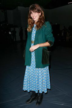 Lou Doillon giving off 90's vibes in a floral maxi, boots, and blazer.