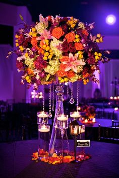 "Why We Love It: Make your centerpieces pop by choosing a contrasting color for uplighting!Why You Love It: ""It's so elegant, classy and intimate!!! The moon behind the centerpiece makes it MAGICAL!!!"" —Sandra Lee V. ""Gorgeous color, and with bling!! And fire!! I would love this!"" —Gloria D. ""Lovely collection of colors."" —Rawan H.Photo Credit: Stevie Ramos Photography"