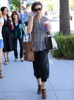 Casual chic: Lily Collins was spotted out on a solo shopping trip in chi-chi Beverly Hills on Thursday