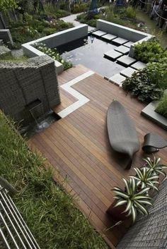 landscape—architecture:  Garden with decking and stretch of water